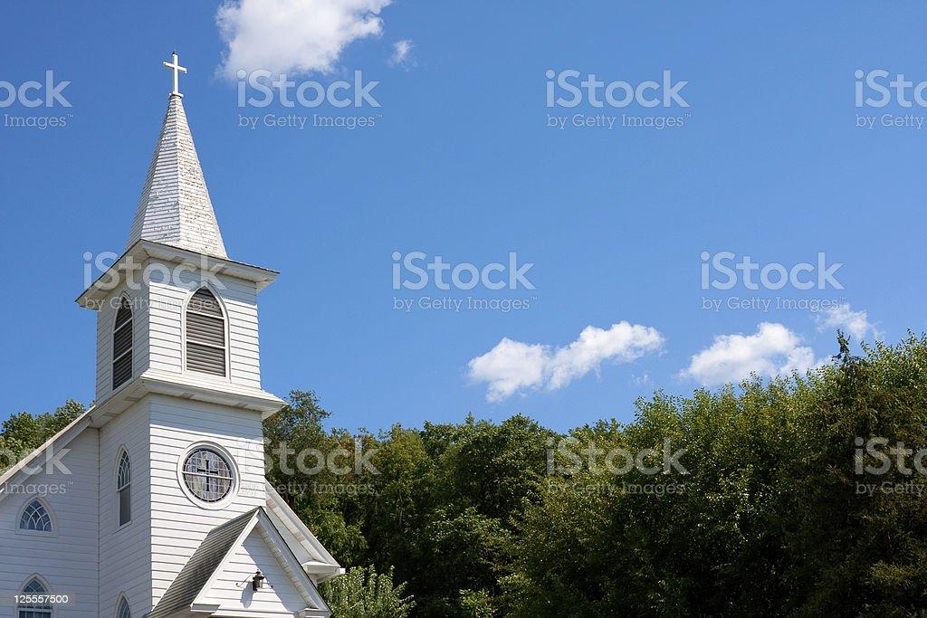 White community church against blue sky stock photo