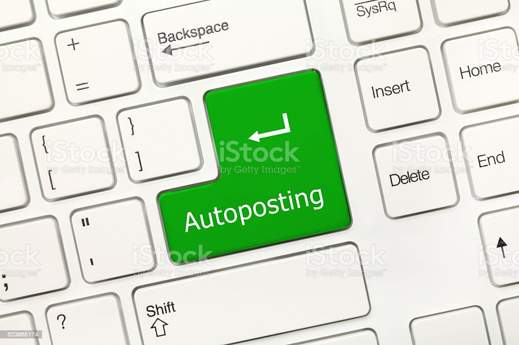 White conceptual keyboard - Autoposting (green key) stock photo