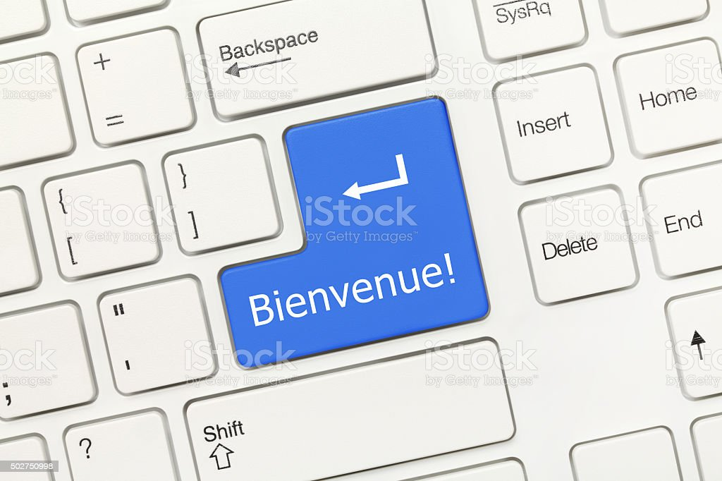 White conceptual keyboard - Bienvenue (blue key) stock photo