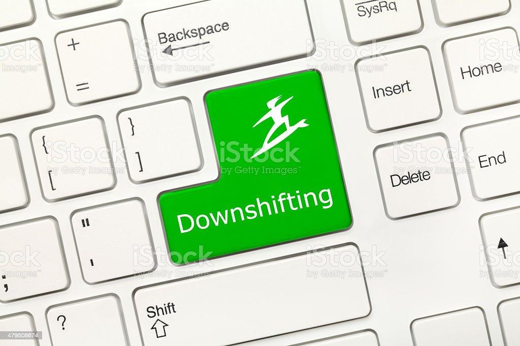 White conceptual keyboard - Downshifting (green key) stock photo
