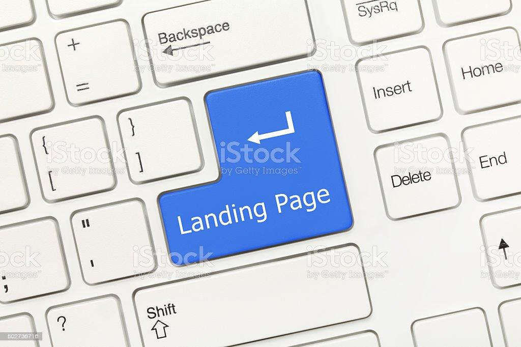 White conceptual keyboard - Landing Page (blue key) stock photo
