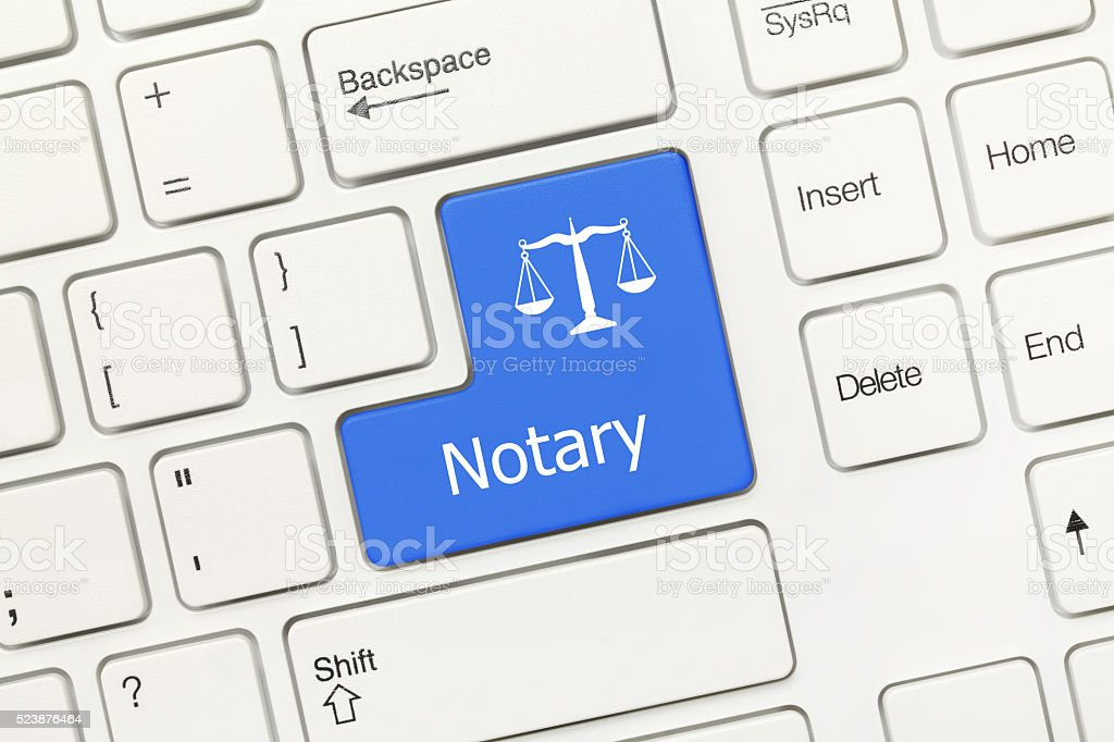 White conceptual keyboard - Notary (blue key) stock photo