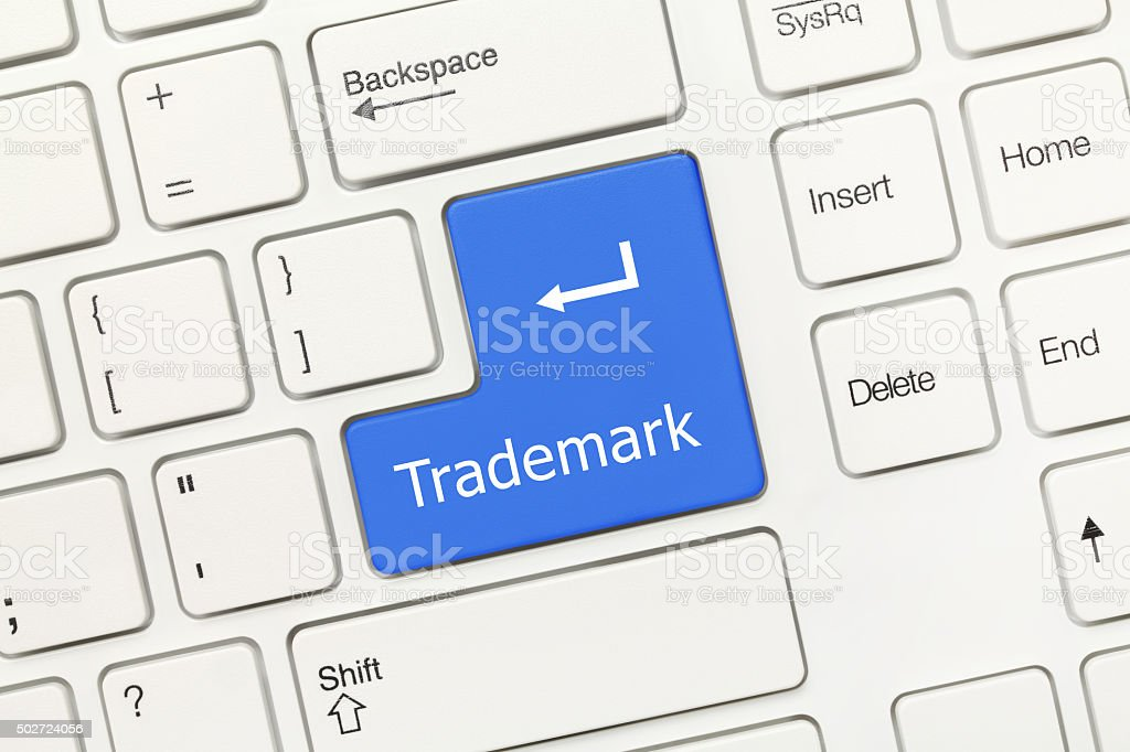White conceptual keyboard - Trademark (blue key) stock photo