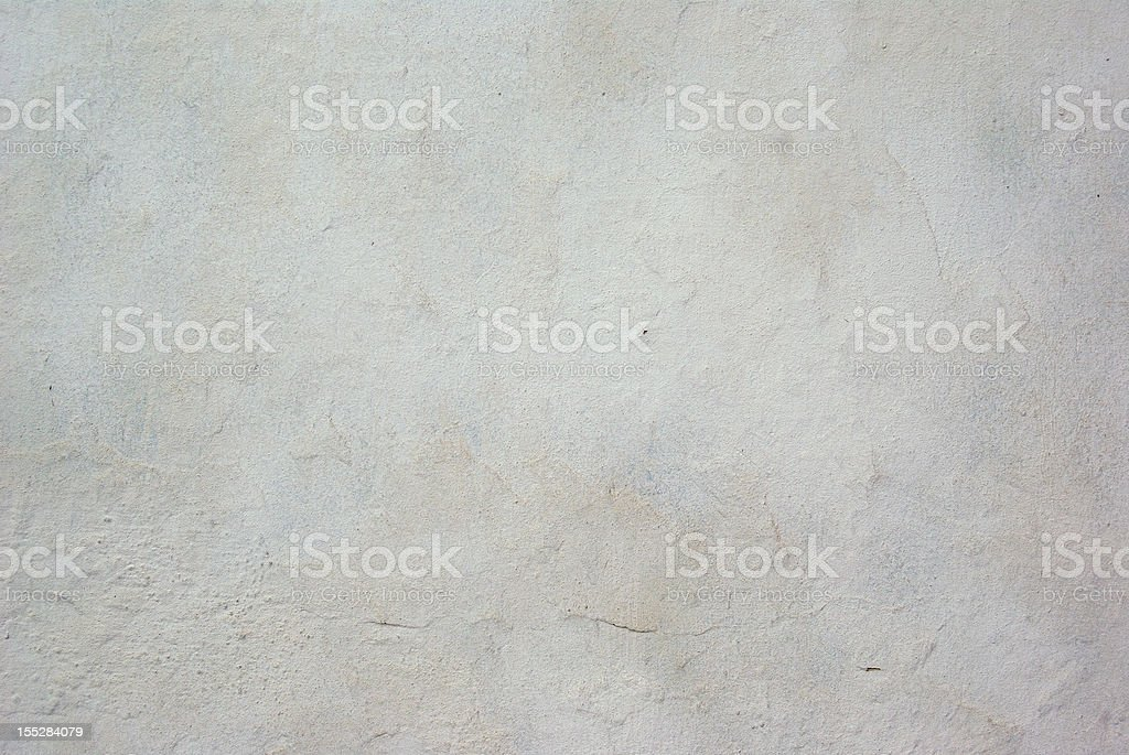 White concrete wall background with little crack stock photo
