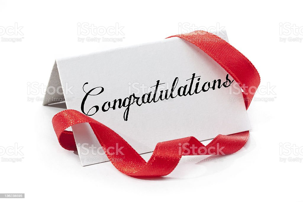 A white congratulations sign and red ribbon stock photo