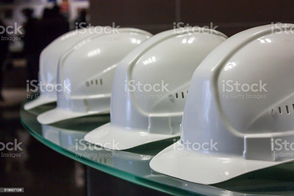 White construction helmets stock photo