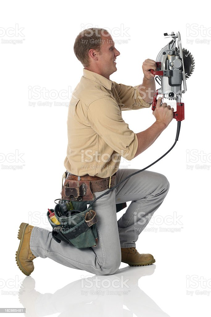 White Construction Worker Sawing royalty-free stock photo