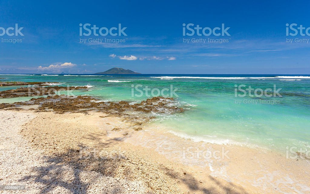 White coral beach on Vanuatu after cyclone Winston. stock photo