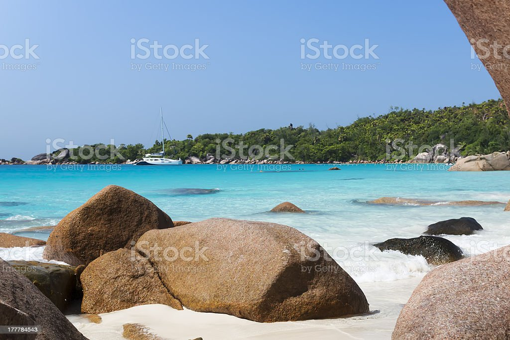 White coral beach sand and azure indian ocean. Sailing yacht royalty-free stock photo