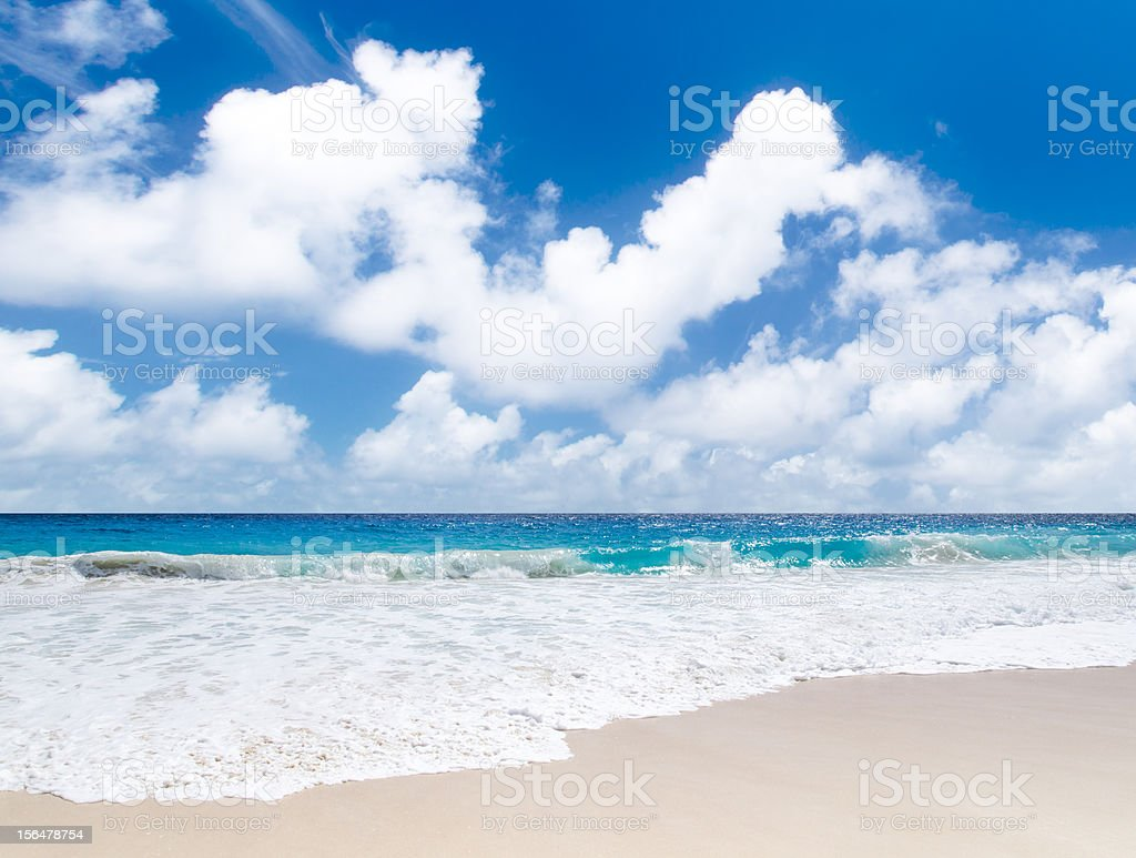 White coral sand and azure indian ocean royalty-free stock photo
