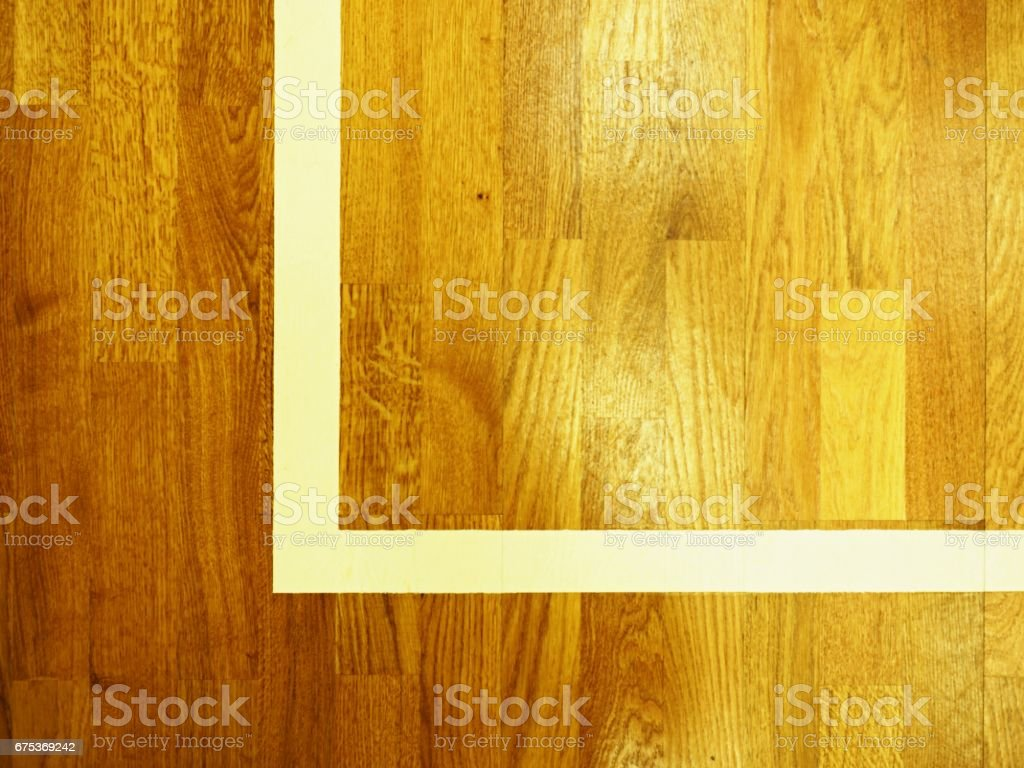 White corner. Worn out wooden floor of sports gym with colorful marking lines stock photo