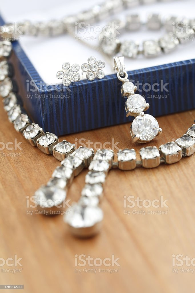 White costume jewelry on gift box stock photo
