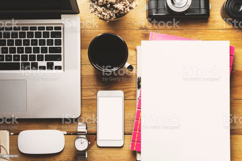 White cover magazine and blank screen phone, flat lay tabletop stock photo