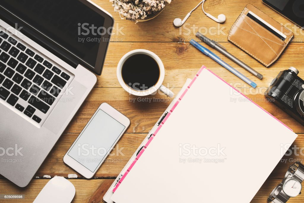 White cover magazine and blank screen phone, tabletop flat lay stock photo