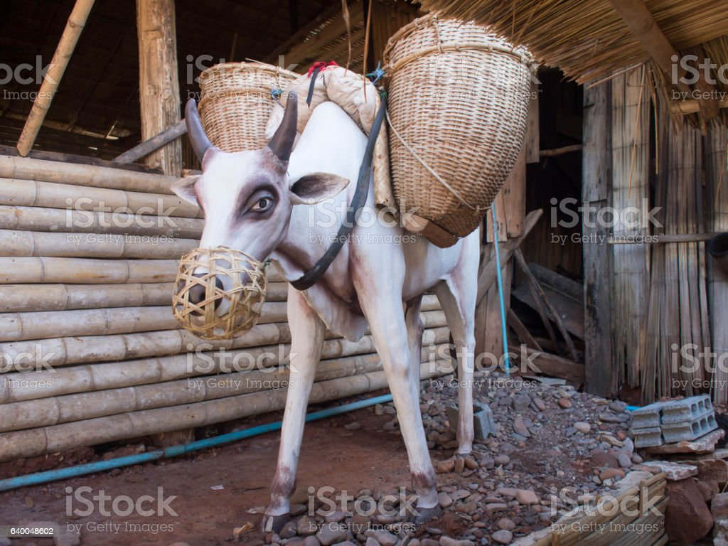 White cow statue carrying the baskets. Thailand ancient. stock photo