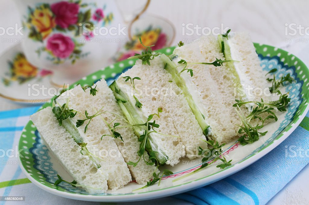 White cream cheese and cucumber sandwiches with watercress stock photo