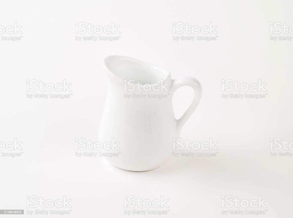 white cream jug stock photo