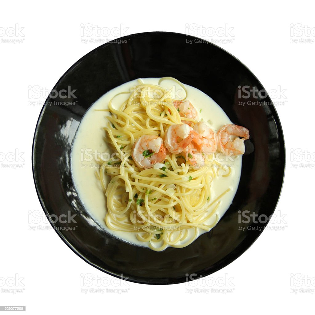 White cream sauce spaghetti with shrimp recipe in black plate. stock photo