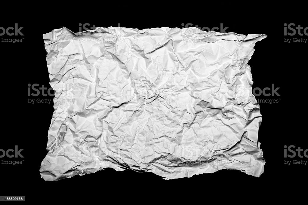 White creased paper isolated on black background stock photo