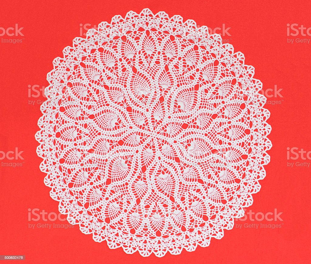 White crochet on red background stock photo