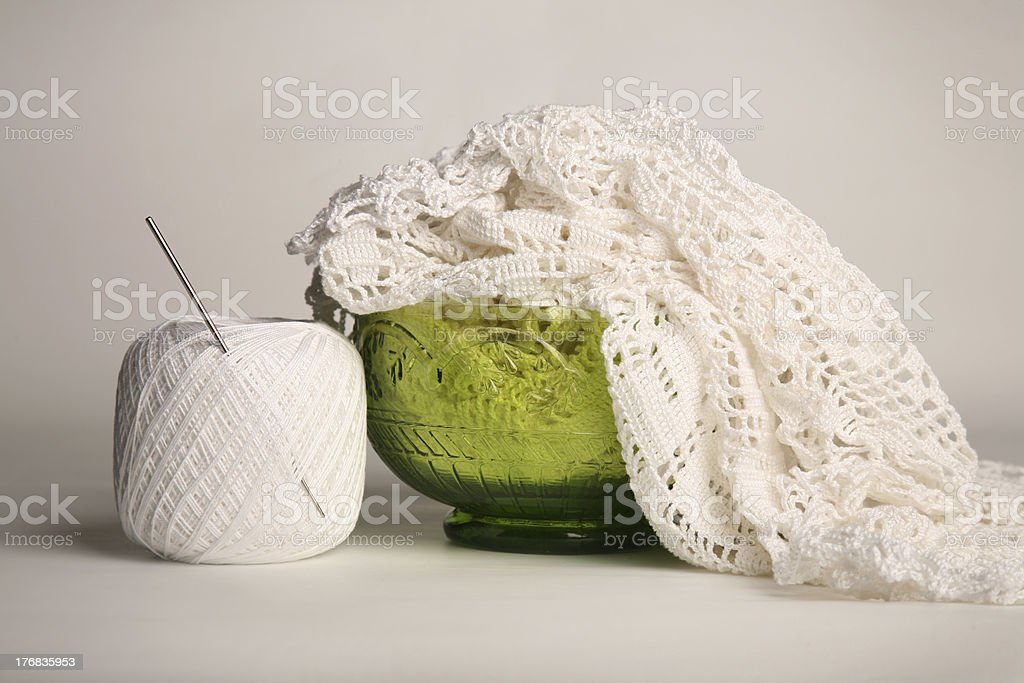 White crochet tablecloth in green bowl royalty-free stock photo
