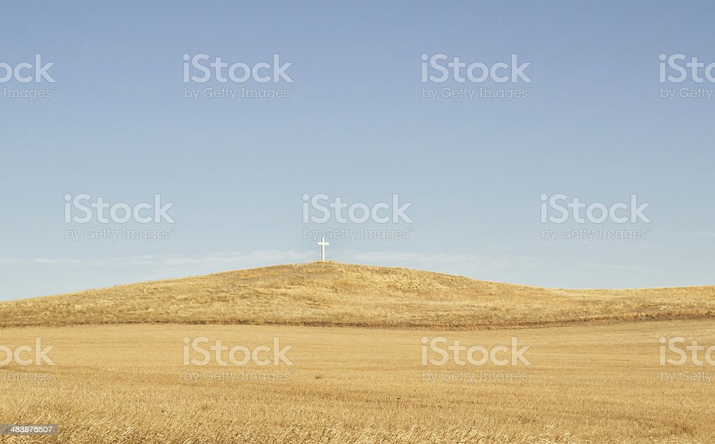 White cross on a hilltop stock photo