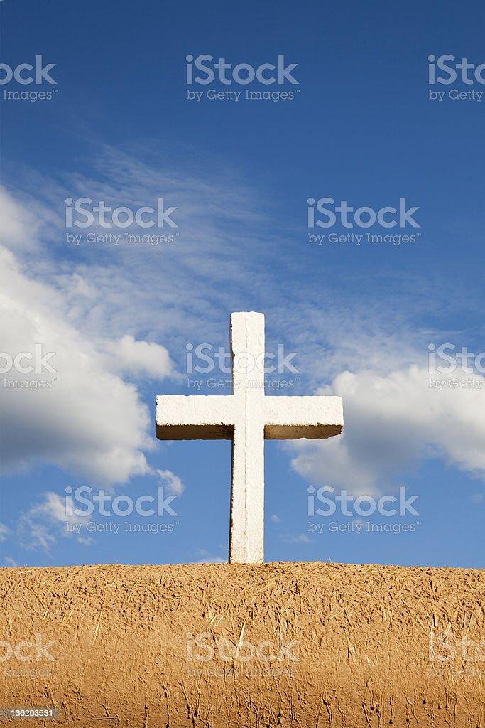 White Cross on Adobe Wall stock photo