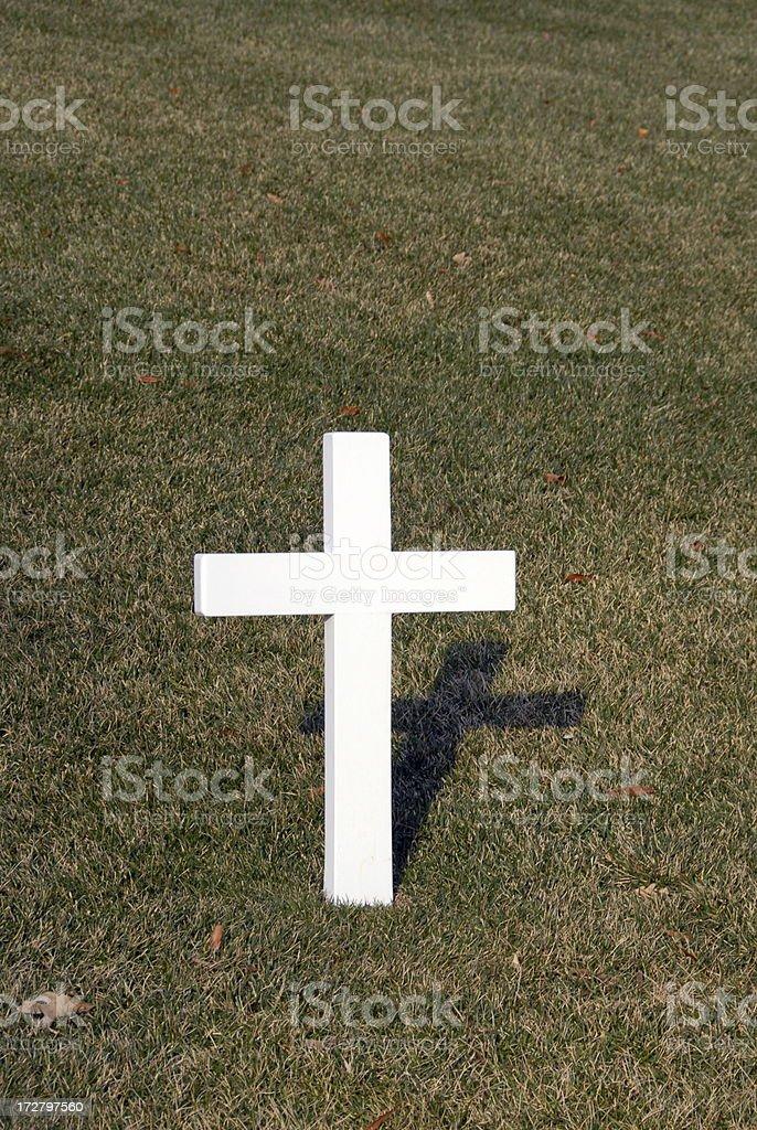 White Cross on Grass Background stock photo
