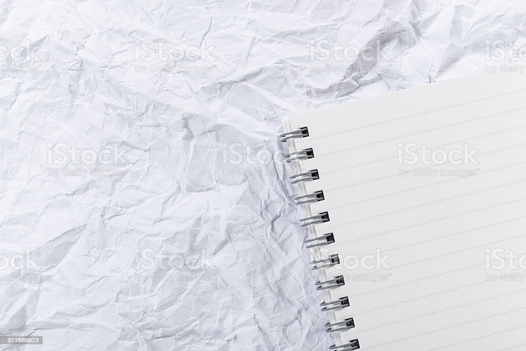 White crumple paper and notepad stock photo