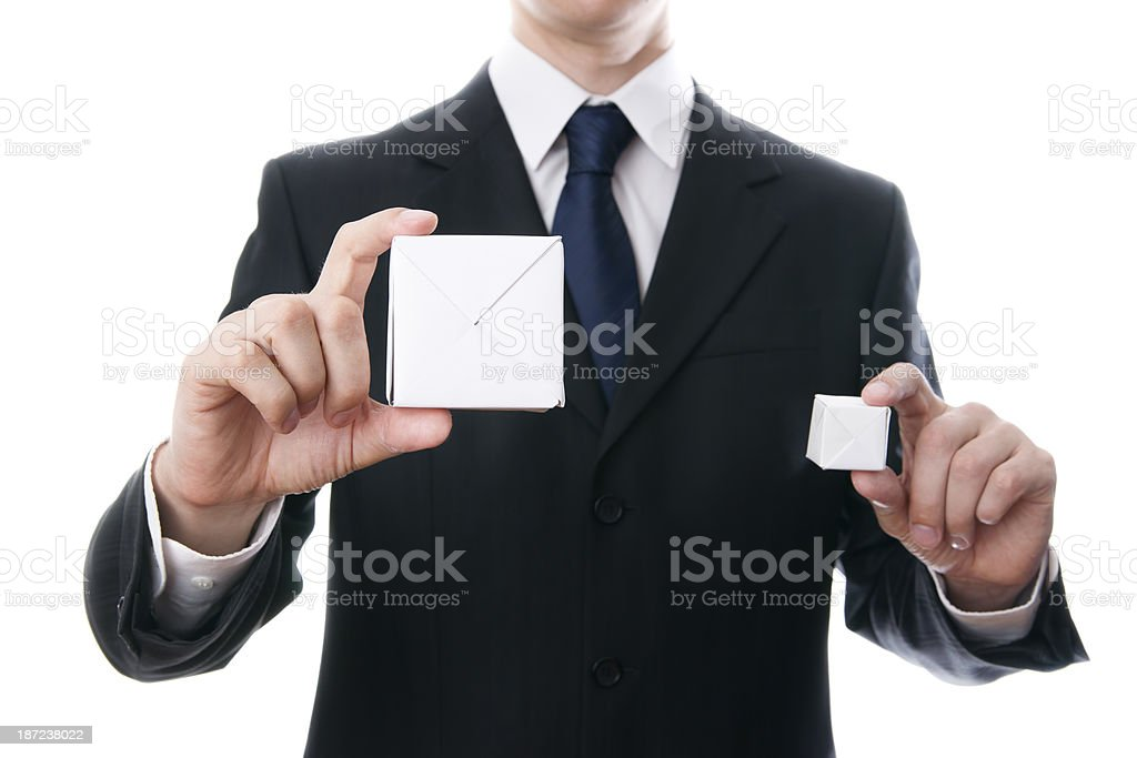White cube on a businessman hand royalty-free stock photo