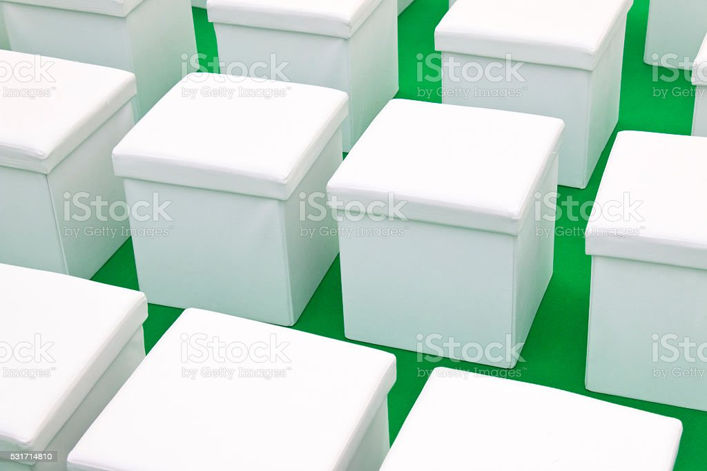 White cubes on green background stock photo