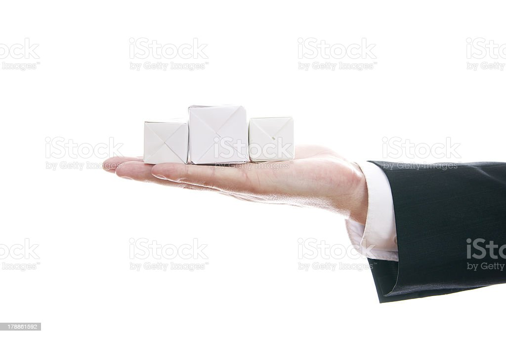 White cubes on hand royalty-free stock photo