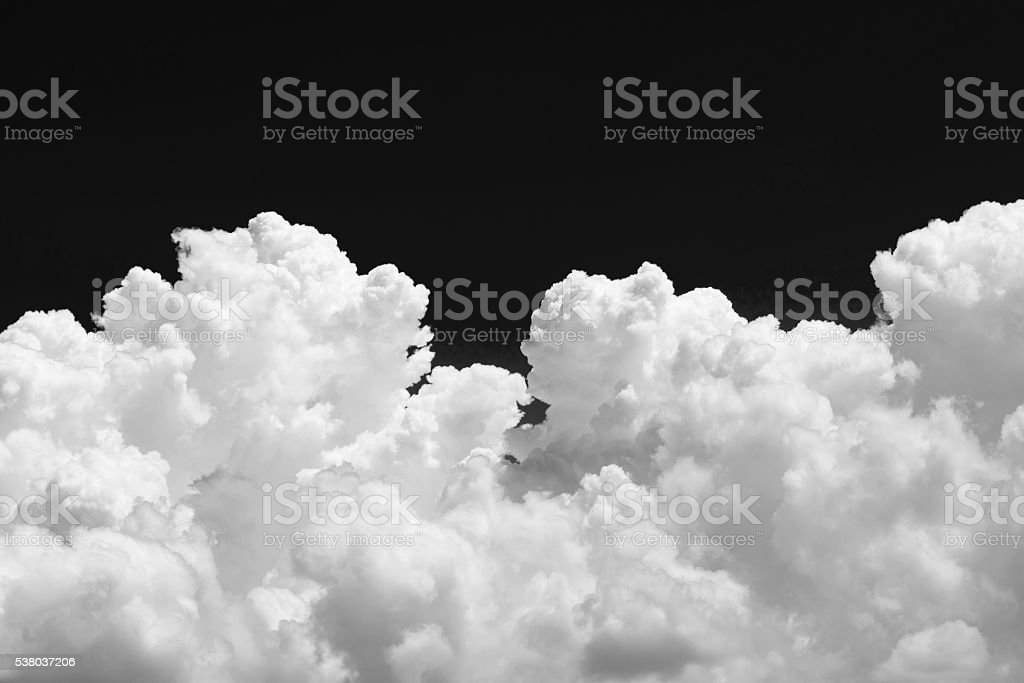 White cumulus cloud on black background stock photo