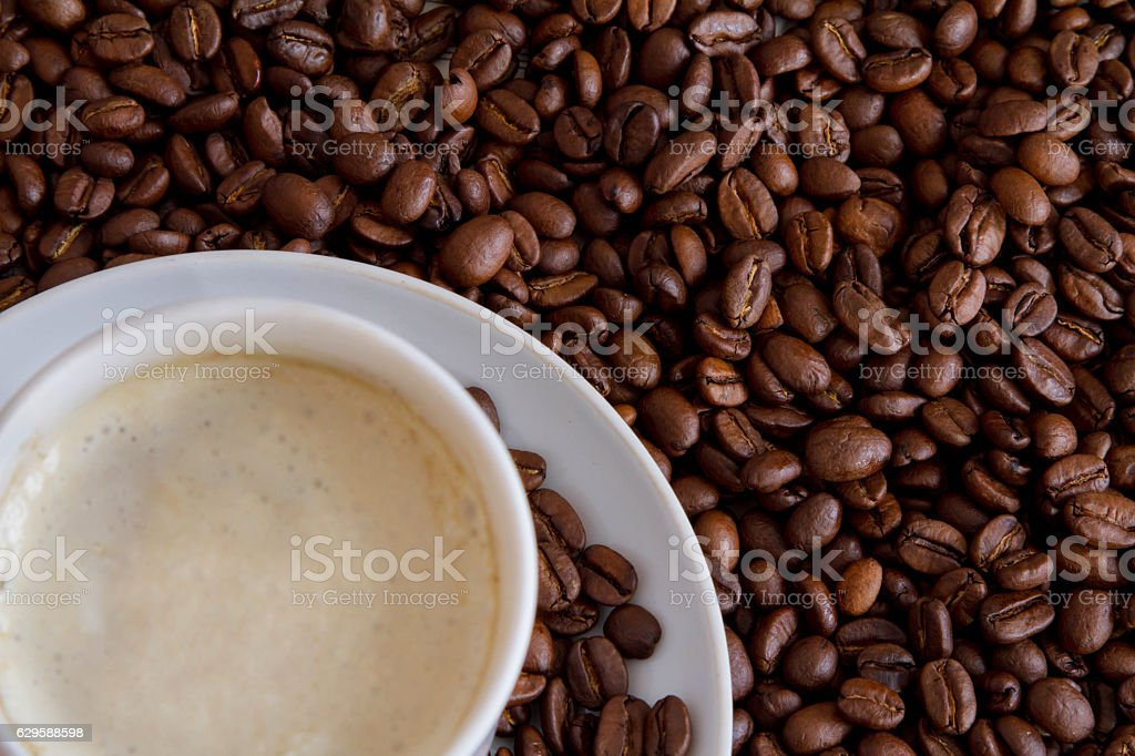 white cup and coffee beans royalty-free stock photo