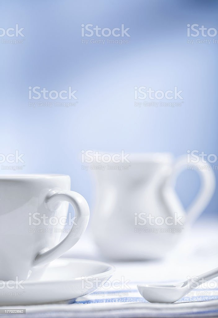 white cup and spoon with jug royalty-free stock photo