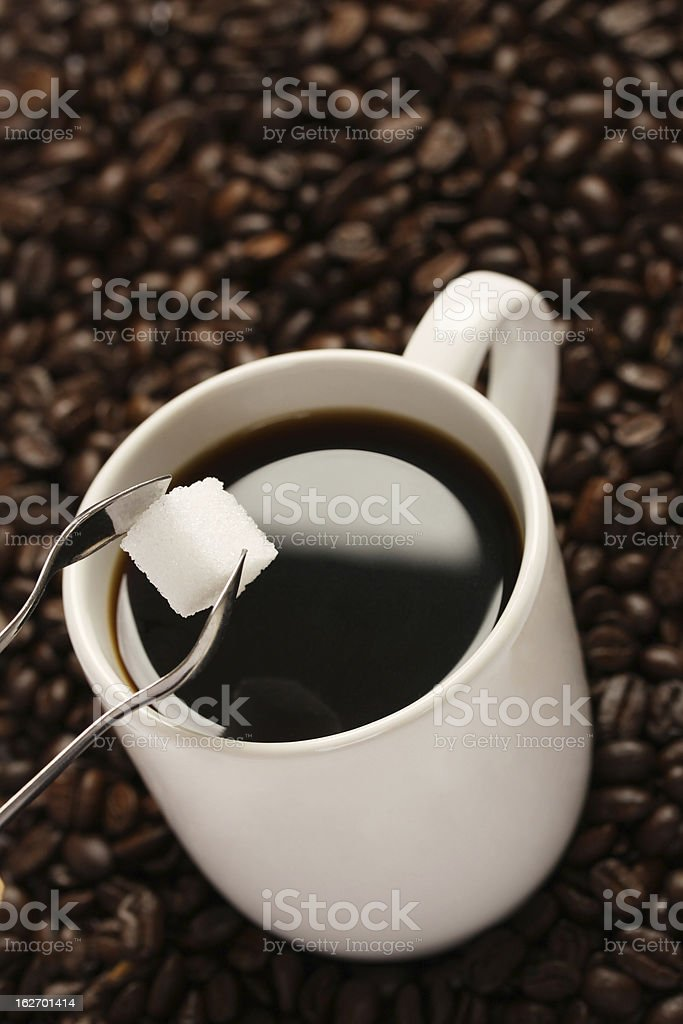 White cup of coffee and sugar lump royalty-free stock photo