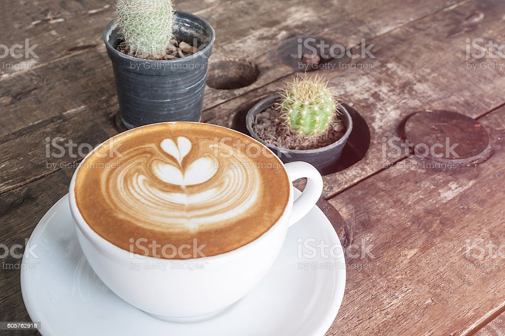 white cup of coffee latte on desk wooden stock photo