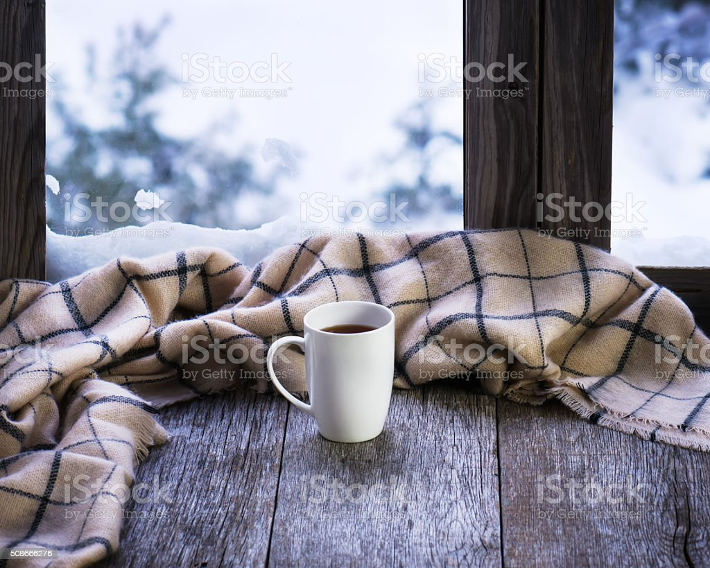 White cup of coffee on stylized wooden window sill. stock photo