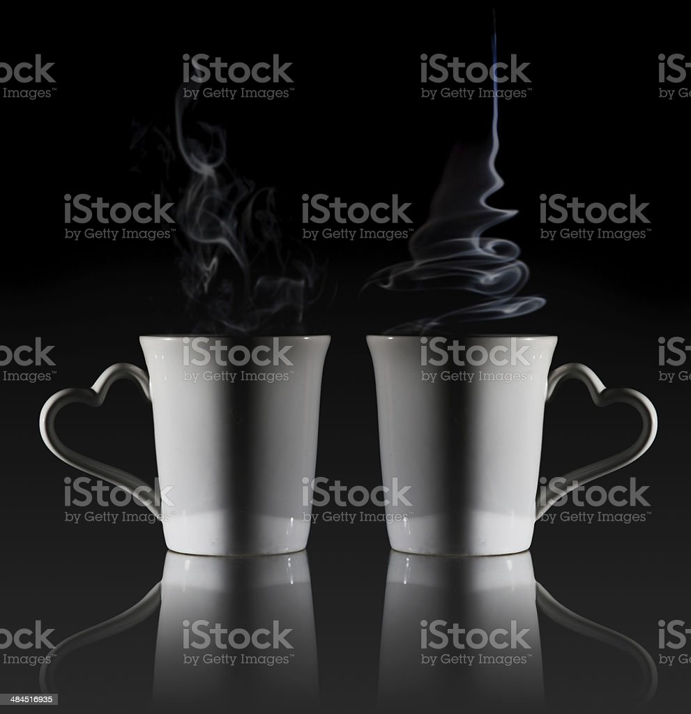 White cup of coffee with a dense smoke stock photo