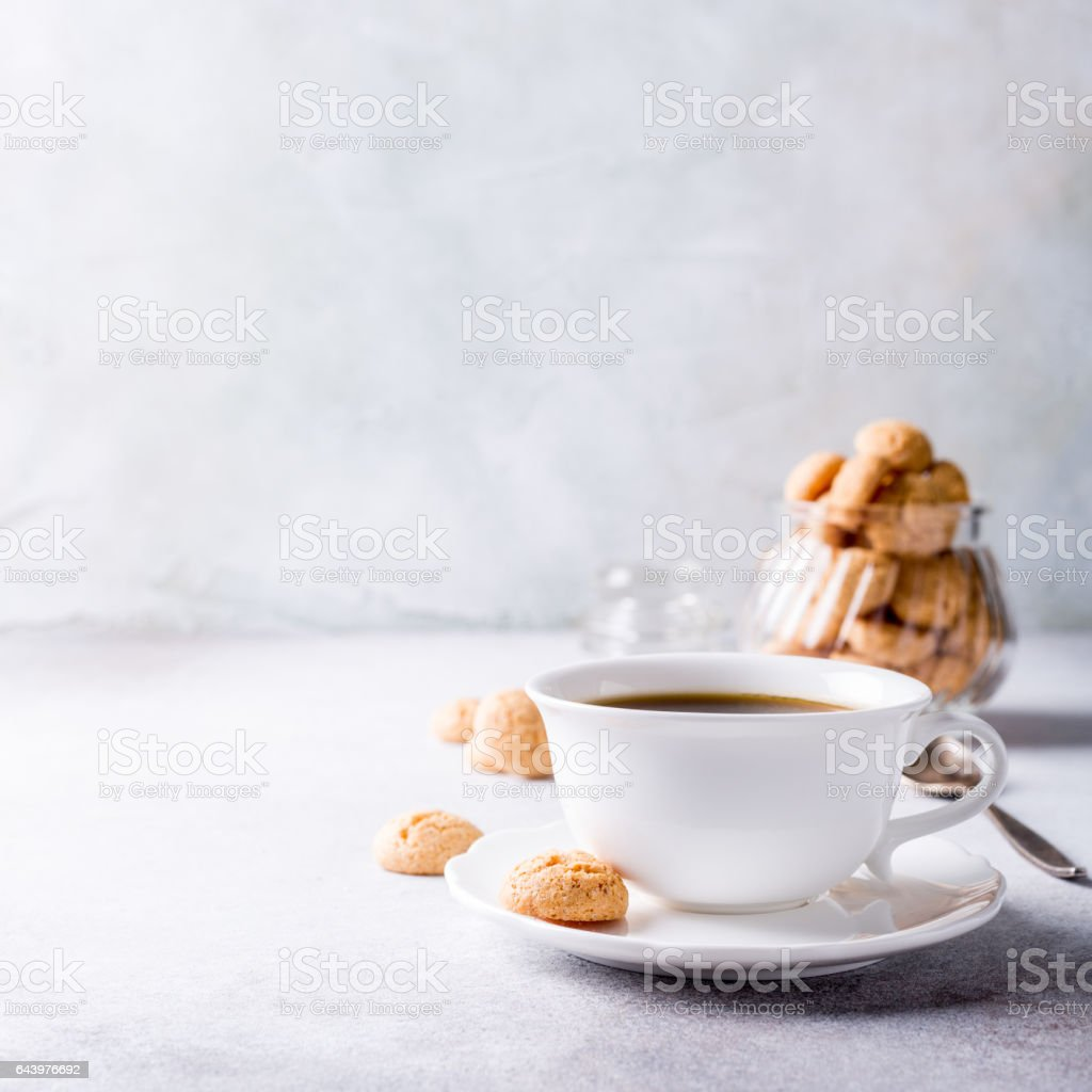 White cup of coffee with amaretti cookies stock photo