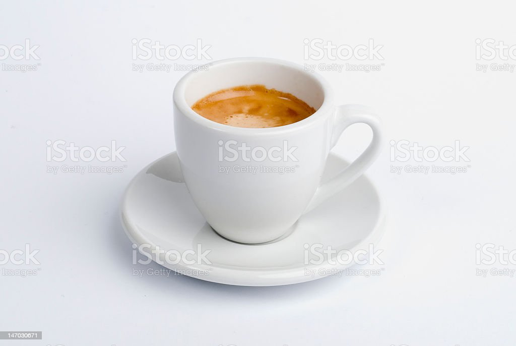 White cup of espresso on saucer royalty-free stock photo