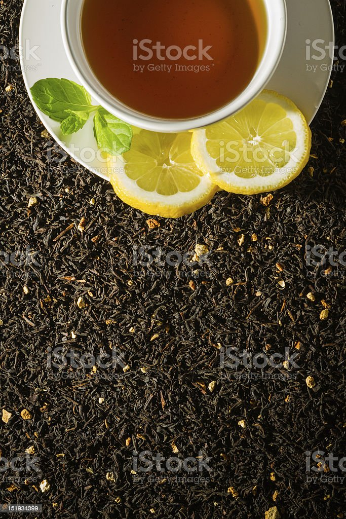 White cup on dried tea background royalty-free stock photo