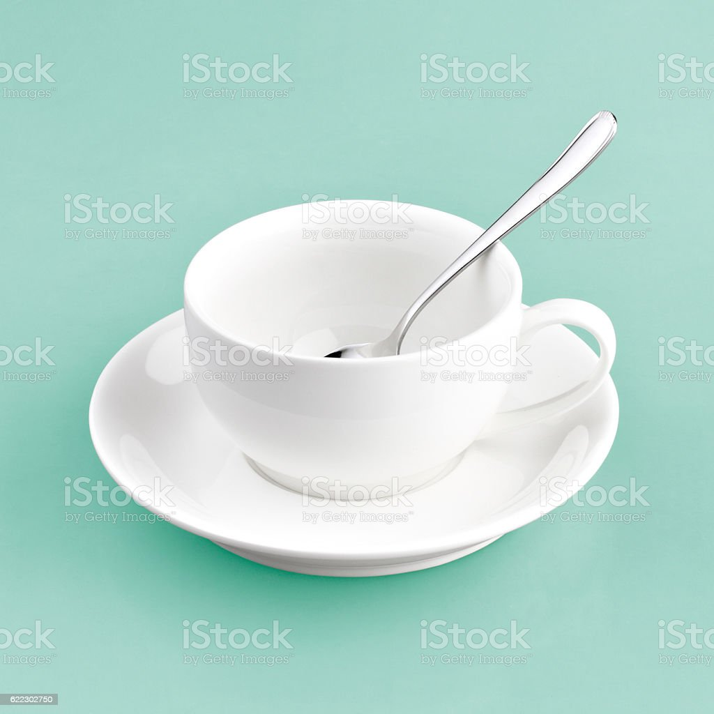 white cup on green blue background stock photo