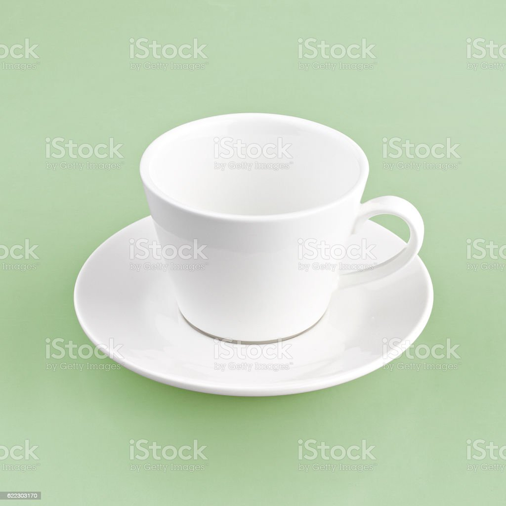 white cup on green yellow background stock photo