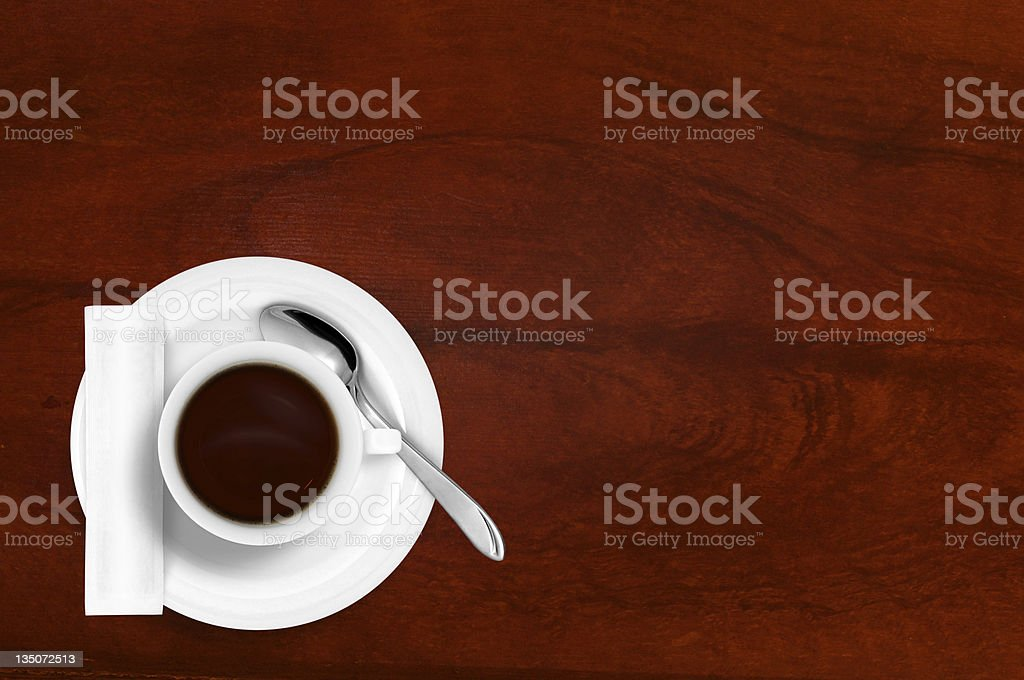 A white cup with black coffee, sugar and a teaspoon royalty-free stock photo