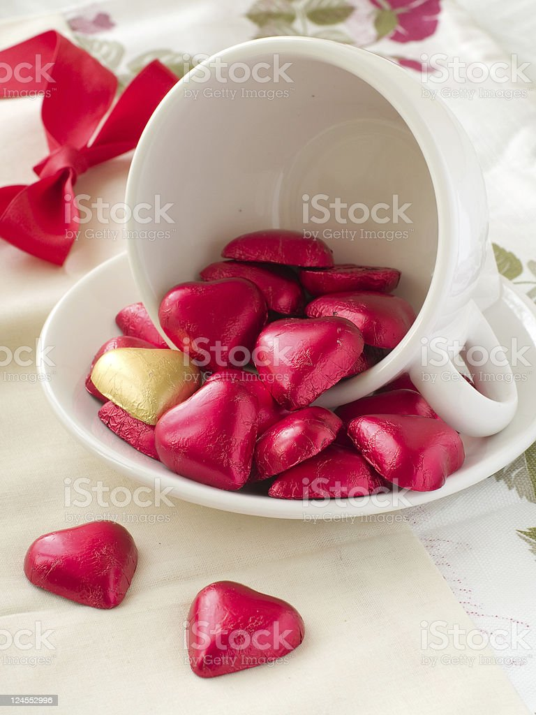 White cup with chocolate hearts royalty-free stock photo