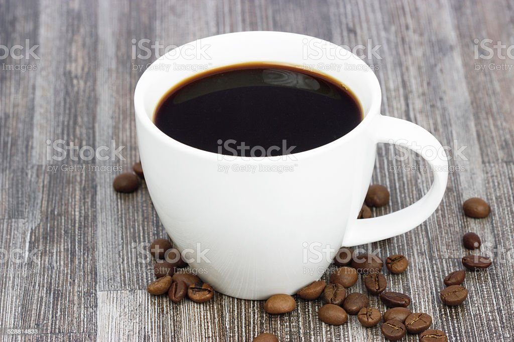 White cup with coffee beans and cup stock photo