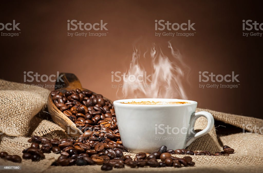 White cup with coffee beans stock photo