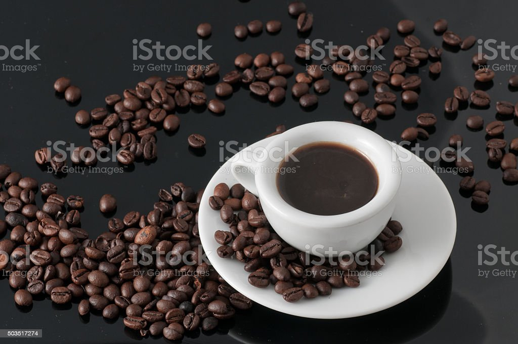 white cup with old Neapolitan grinder coffee stock photo