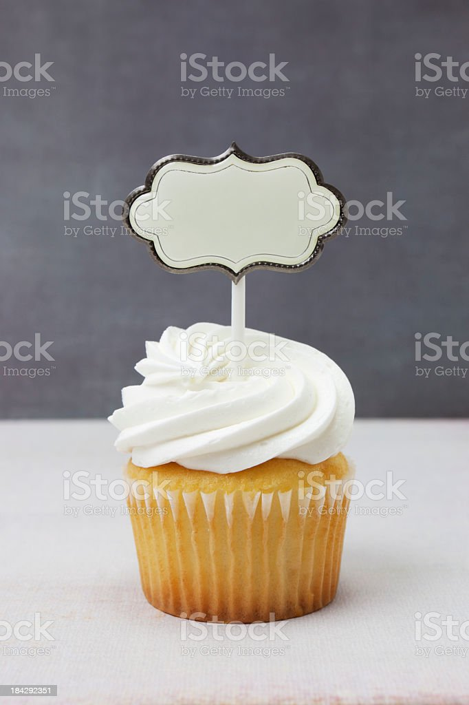 White cupcake with banner royalty-free stock photo